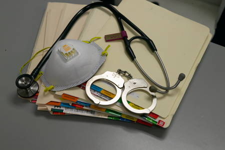 Picture of handcuffs and stethoscope